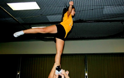 Cheer team somersaults into competitive season