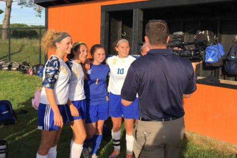 Soccer buzzes past Holly, meets Fenton in district championship