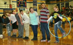 Freshmen race with a hula hoop