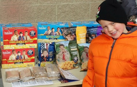Cub Scout Ben Sherlock sells popcorn outside of Sam's Club in Grand Blanc on Nov. 1.
