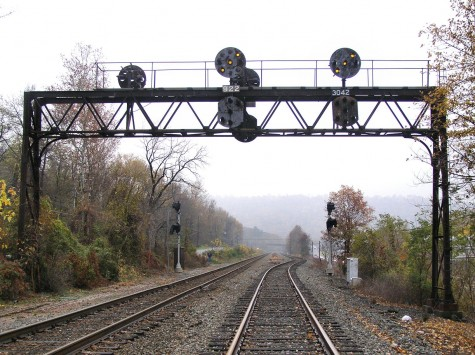 PRR signal bridge at MP 304 on the Buffalo Line on the Pennsylvania Railroad lit up for an approaching train.