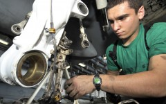 Aviation Structural Mechanic 3rd Class Donald Elder replaces an axle lever on the landing gear of an F/A-18C Hornet aboard the aircraft carrier USS Harry S. Truman (CVN 75).