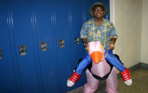 Hutchinson rides an inflatable ostrich for Halloween