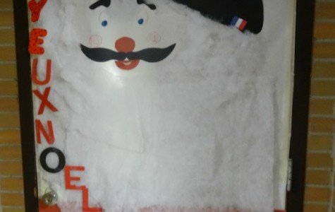 Santa takes on a French persona on Madame Rouvelin's door