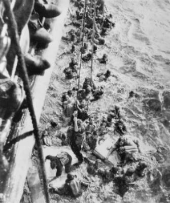 The HMS Dorsetshire rescuing Bismarck survivors from the sea.