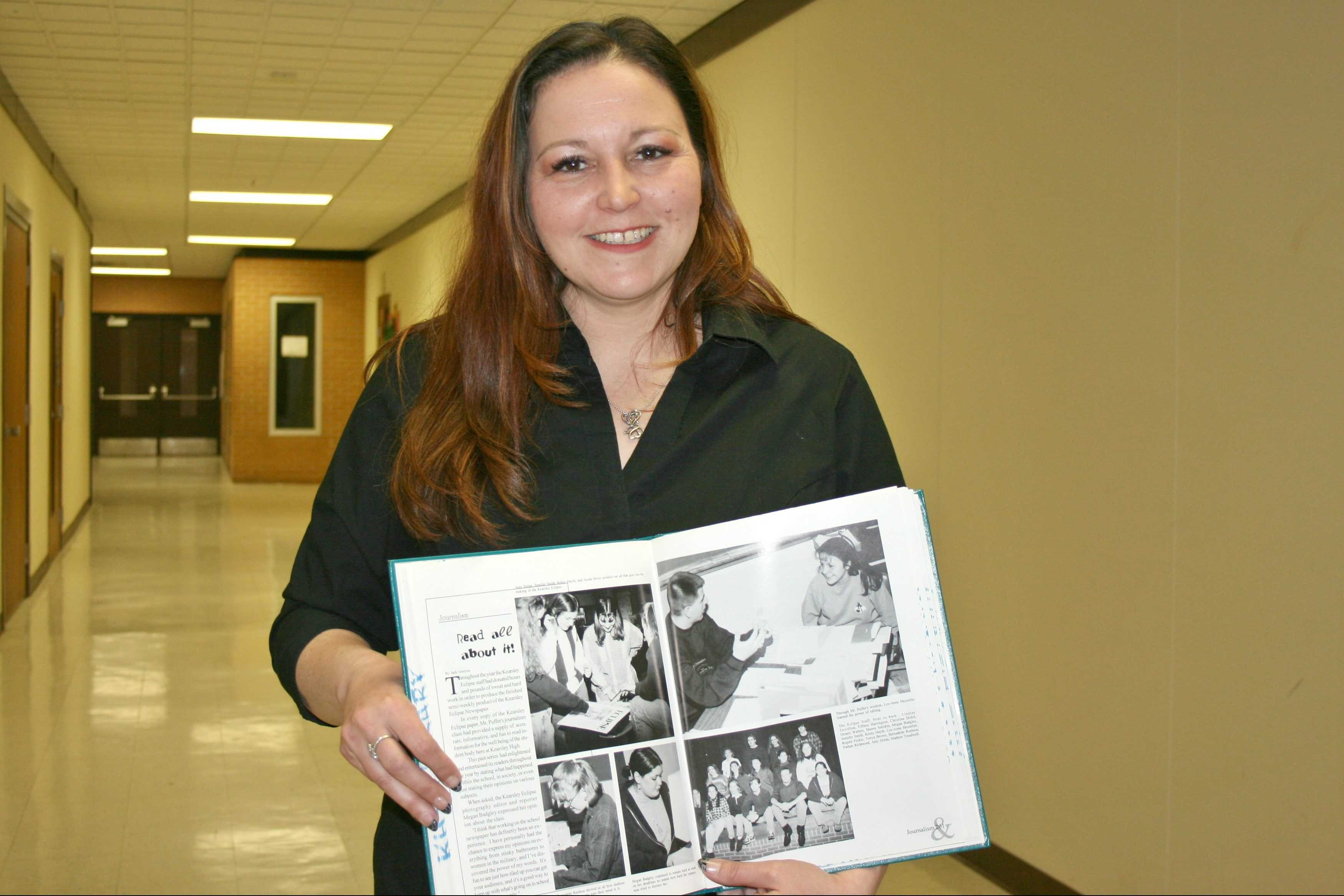 Mrs. LeeAnne Walters, a Kearsley alumna, holds her 1996 yearbook showing a picture of herself when she was an editor for The Eclipse.