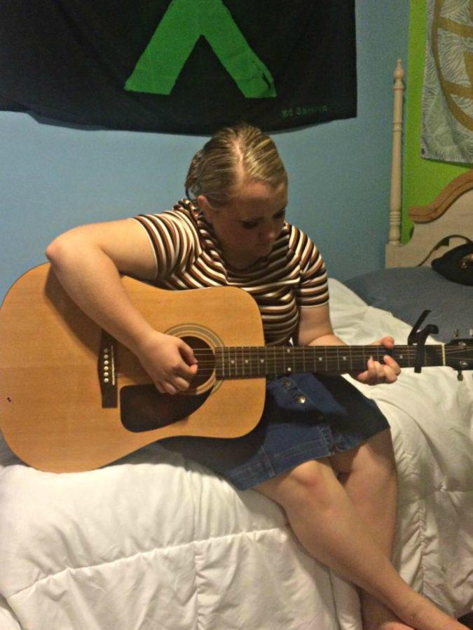 Erin Davis, senior, plays the guitar.