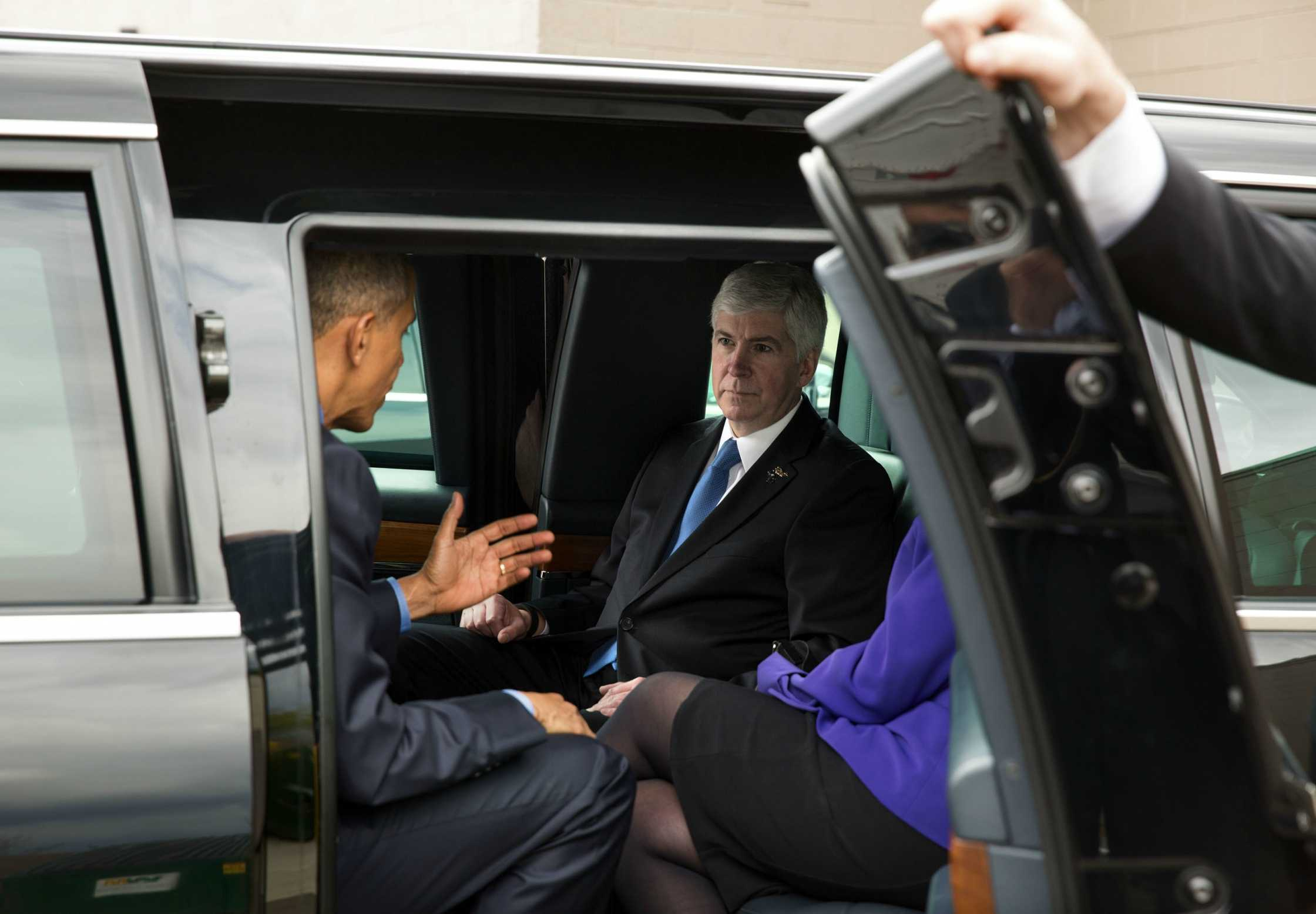 President Barack Obama talks with Gov. Rick Snyder as they arrived at Food Bank of Eastern Michigan in Flint on May 4, 2016. The governor rode in the motorcade with the President from the airport.