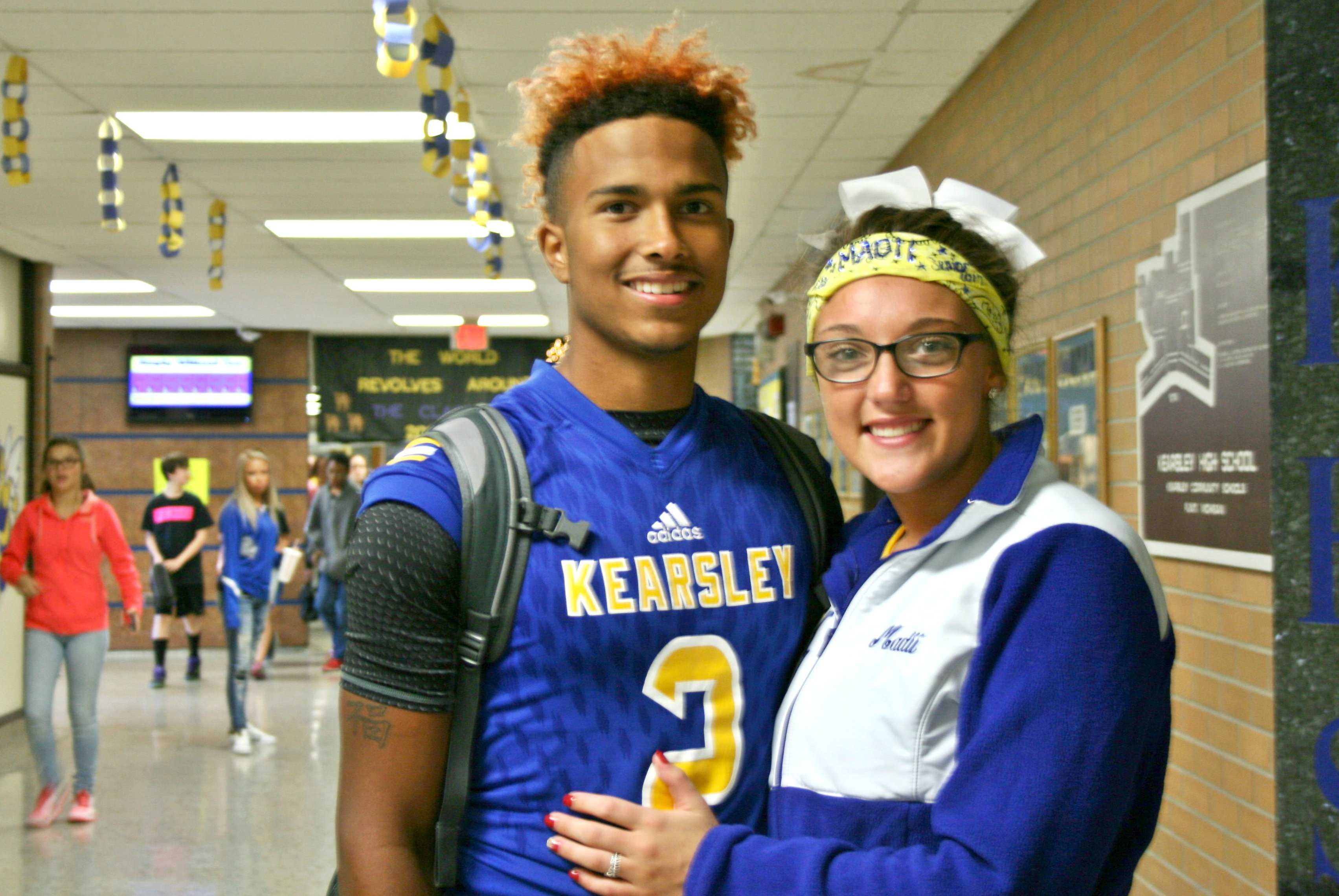Seniors Christian Pinkney (left) and Madii Chapman wear their school colors proudly.