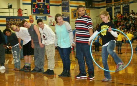Freshmen race with a hula hoop