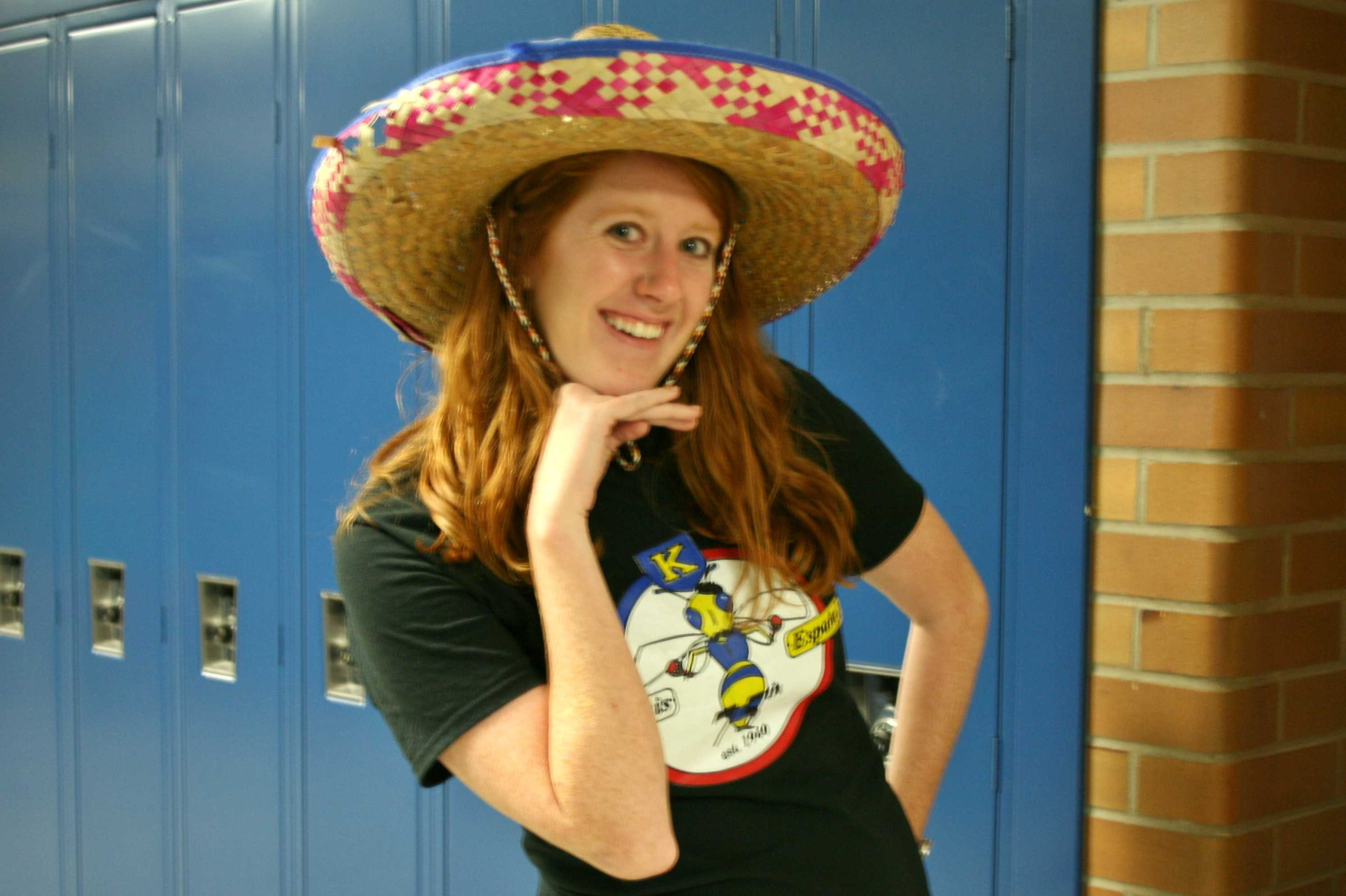 Ms. Caitlin Hudgins shows off her sombrero as a tourist from Mexico for Tourist Thursday.