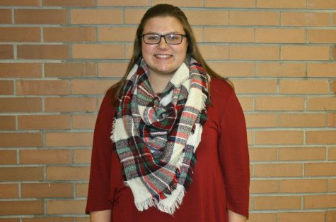 Bailee Stevens, junior, shows off her fall spirit with a plaid scarf.