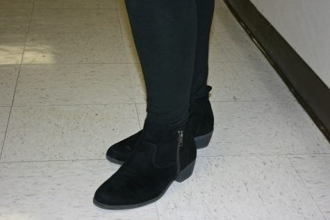 Emalie Lewis, junior, sports black booties for he fall weather.