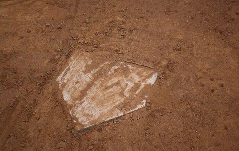 Softball loses season opener, bounces back