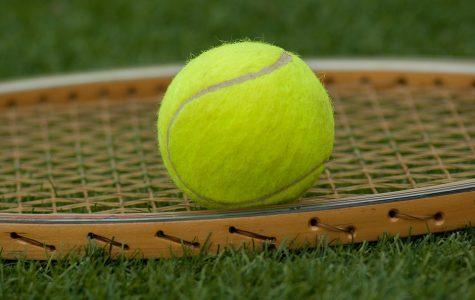 Tennis wins first home match of season