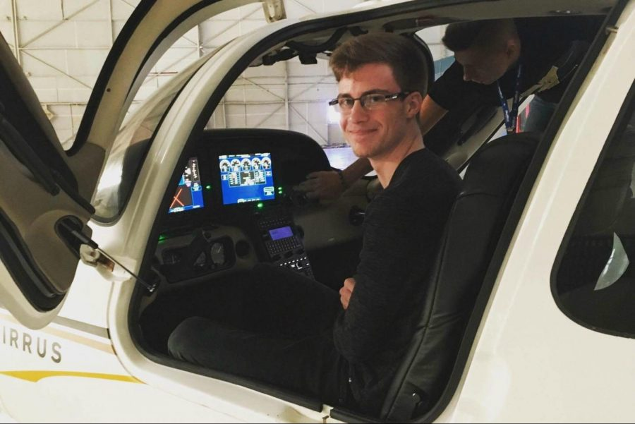 Senior Wiliam Spielmaker sits in the cockpit of a plane at Western Michigan University's aviation facility. Spielmaker plans on attending WMU and studying aviation.