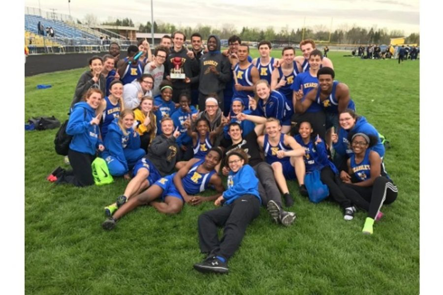 07383ea7c7c8 Athletes from the boys and girls track and field teams celebrate with the  K-O Clash trophy