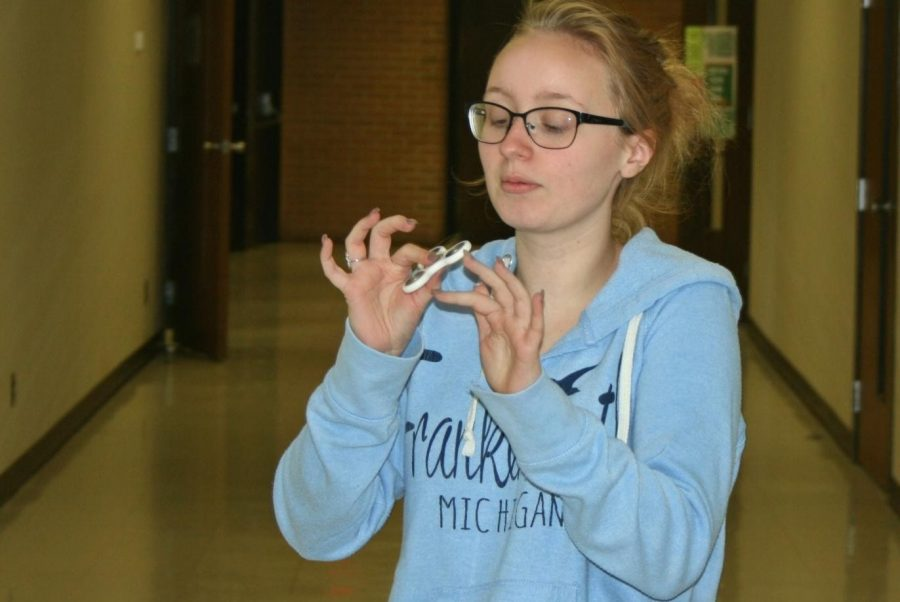 Sophomore Lindsey Bouchard plays with a fidget spinner during lunch.