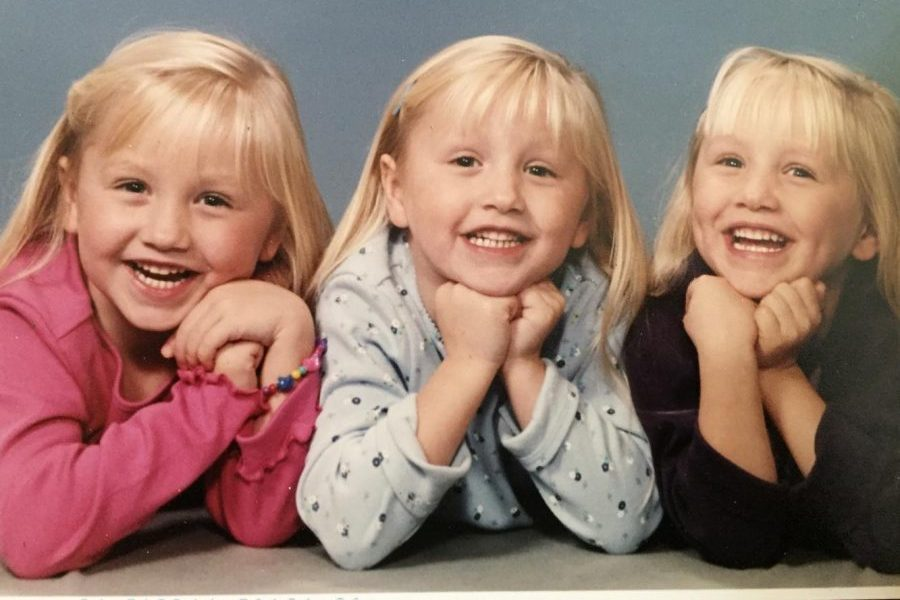 Juniors Kaitlyn, (l to r) Hannah, and Amanda VanOoteghem are triplets who share everything in their lives. In this photo, they were, obviously, young children.