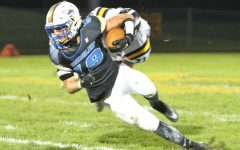 Football scores season high, tackles Owosso on Homecoming