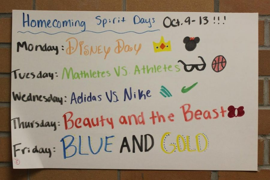 Student Council members made posters displaying the spirit days for homecoming week and hung them around the school.