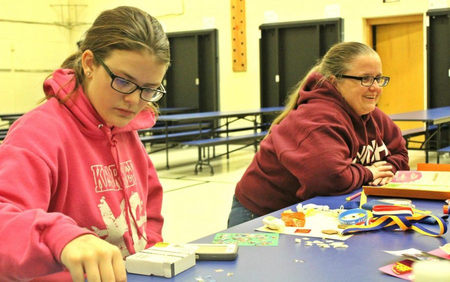 Sophomore Samantha Timm (left) creates an art project at her Girl Scout meeting Monday, Nov. 13. Mrs. Kimberly Timm (right) is the troop leader.