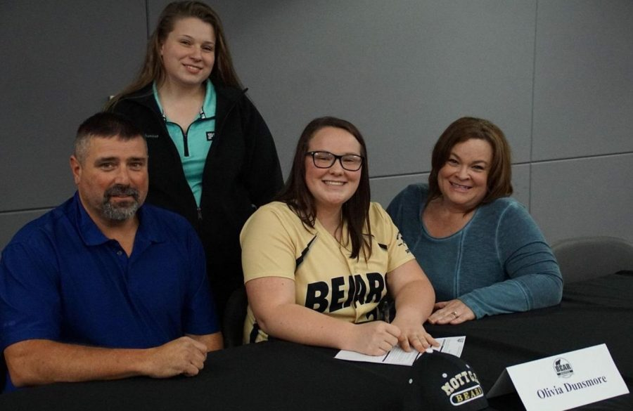 Mr. Matt Dunsmore, father, (l to r), sister Ms. Madilynn Dunsmore, senior Olivia Dunsmore, and mother Mrs. Kate Dunsmore sit together as Olivia Dunsmore proudly signs her National Letter of Intent on Wednesday, Nov. 1, at Kearsley.