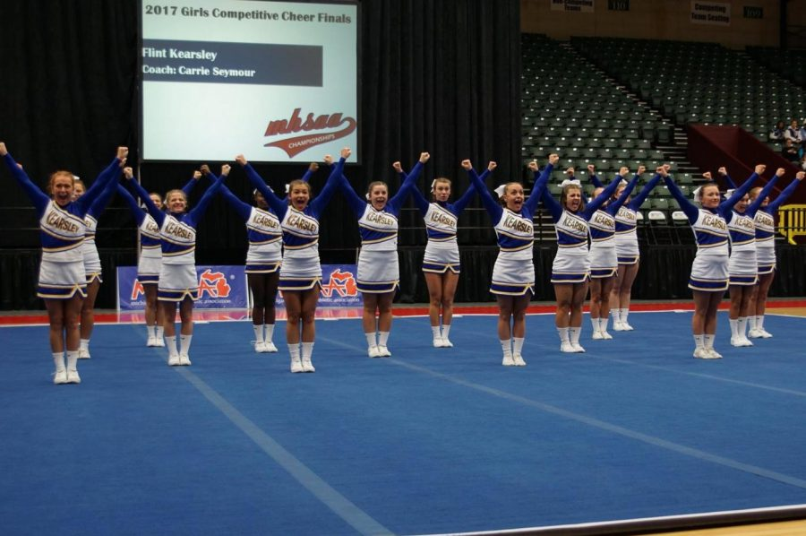 The+cheer+team+performs+during+the+2017+state+final+on+Saturday%2C+March+4%2C+at+the+Delta+Plex+in+Grand+Rapids.+Tryouts+for+the+2017-18+cheer+season+are+Tuesday%2C+Nov.+7.