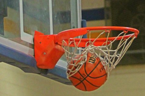 Boys basketball slain by Dragons