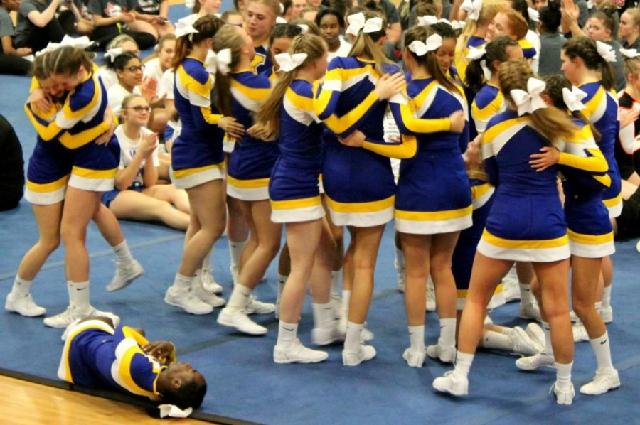 After hearing the final scores of the jamboree, the cheer team celebrates its league championship Wednesday, Feb. 7, at Kearsley.