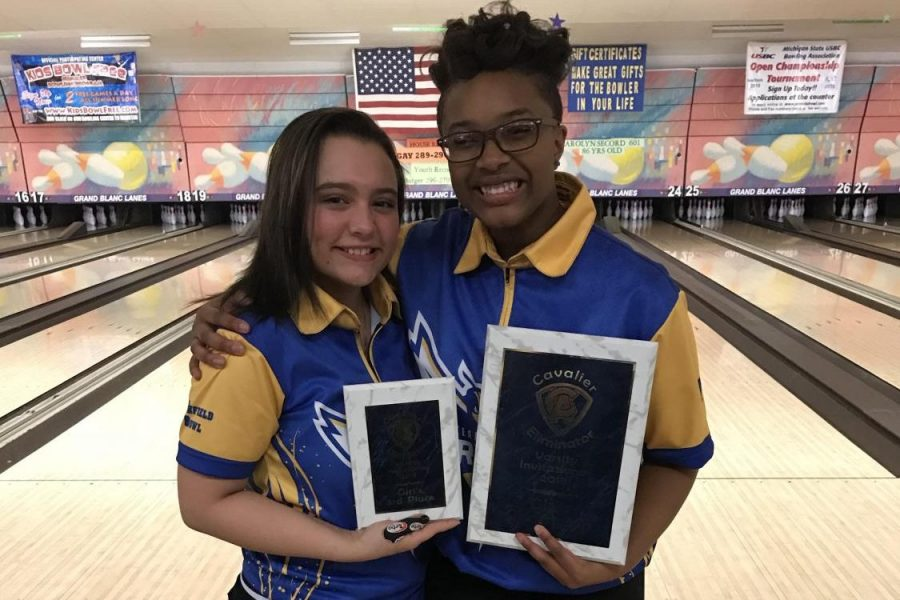 Senior Karlee Griffin (left), and sophomore Imari Blond celebrate with their plaques from the Carman-Ainsworth Singles Tournament on Sunday, Feb. 4. Blond won the tournament and Griffin finished third.