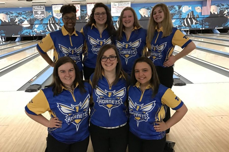 The girls bowling team enjoys having defended its ninth consecutive league title on Thursday, Feb. 15.