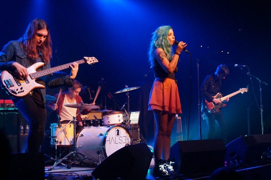 Halsey performs with her band during The American You(th) Tour in 2015.