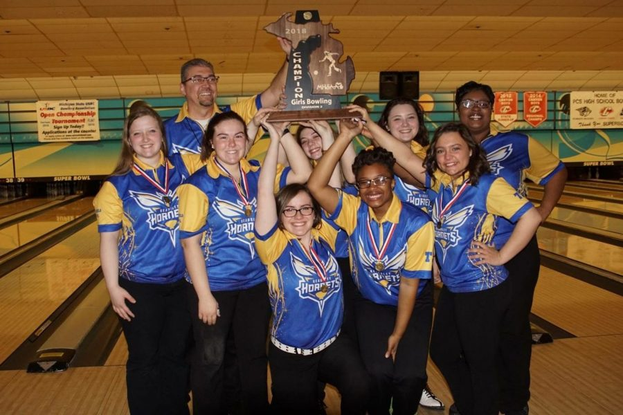The girls bowling team celebrates its fifth consecutive state title, Friday, March 2, after winning the MHSAA Division 2 tournament at the Super Bowl in Canton.