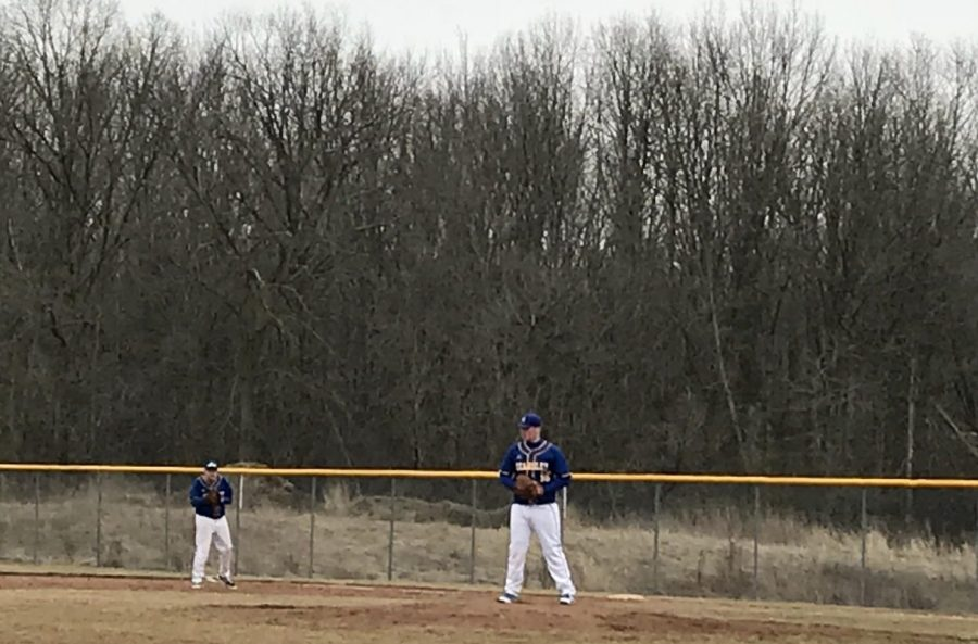 Freshman Kody Easton approaches the pitchers mound at the doubleheader Monday, March 26, against Carman-Ainsworth.