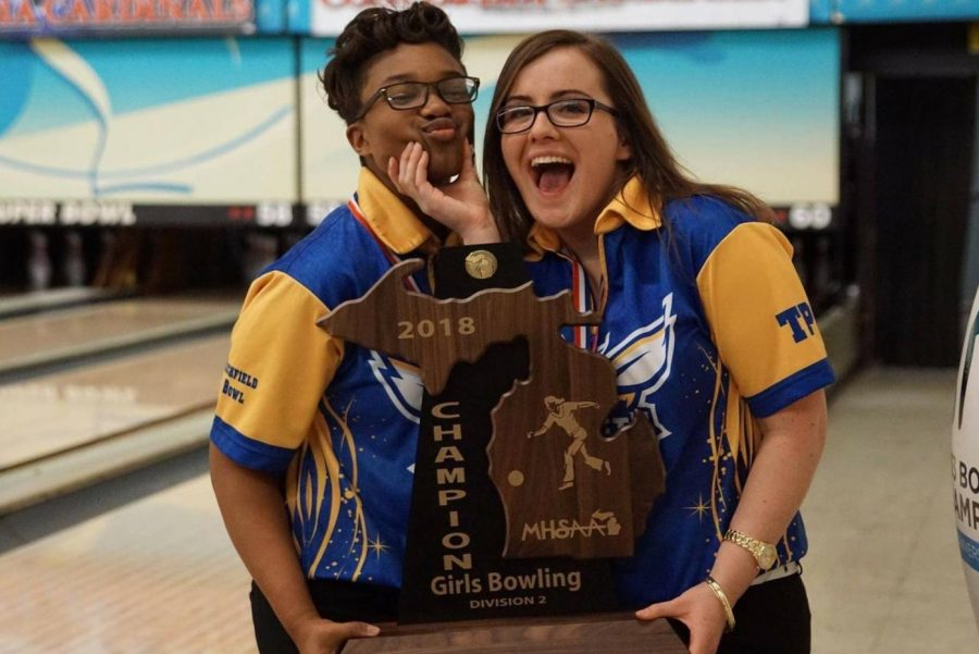 Sophomore Imari Blond (left) and senior Barbara Hawes pose happily with their team state title trophy. The girls both made the final four in the MHSAA Division 2 singles state final, Saturday, March 3. Blond advanced to the state title match, and finished second in the state.