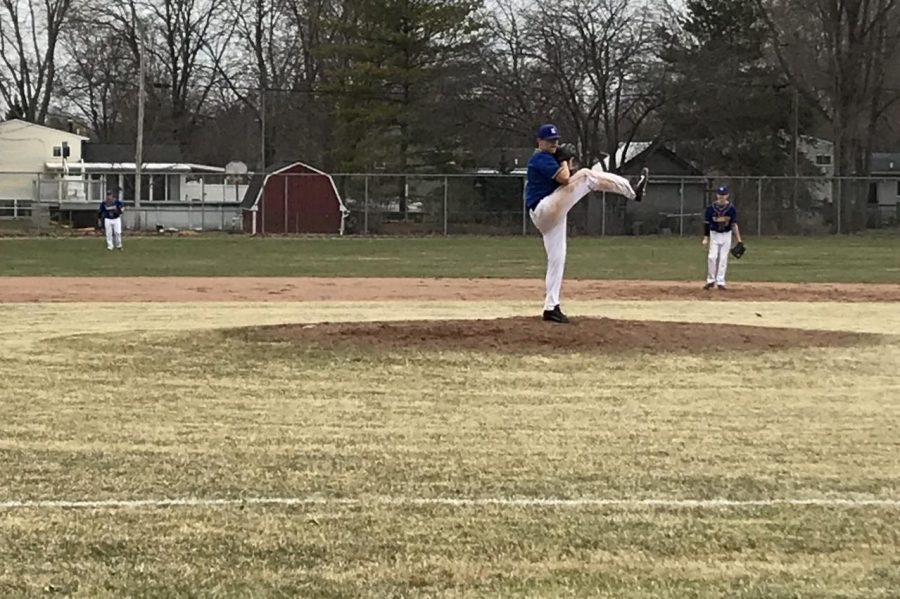 Junior Dustin Bennett pitches for the Hornets during the first game.