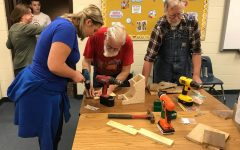 Woodworkers teach students how to make bird houses