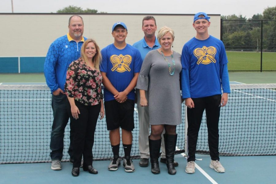 Seniors Kyle Langworthy (third from left)  and Marshall Judd (far right) stand with their parents at their match against Flushing on Monday, Sept 24.