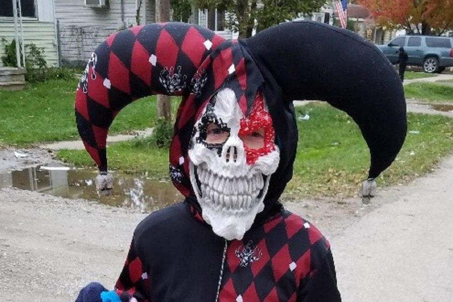 Logan Coleman, 10, wears his scary joker costume for Halloween in 2017. This costume would be unacceptable to wear to school because the mask covers the face completely.