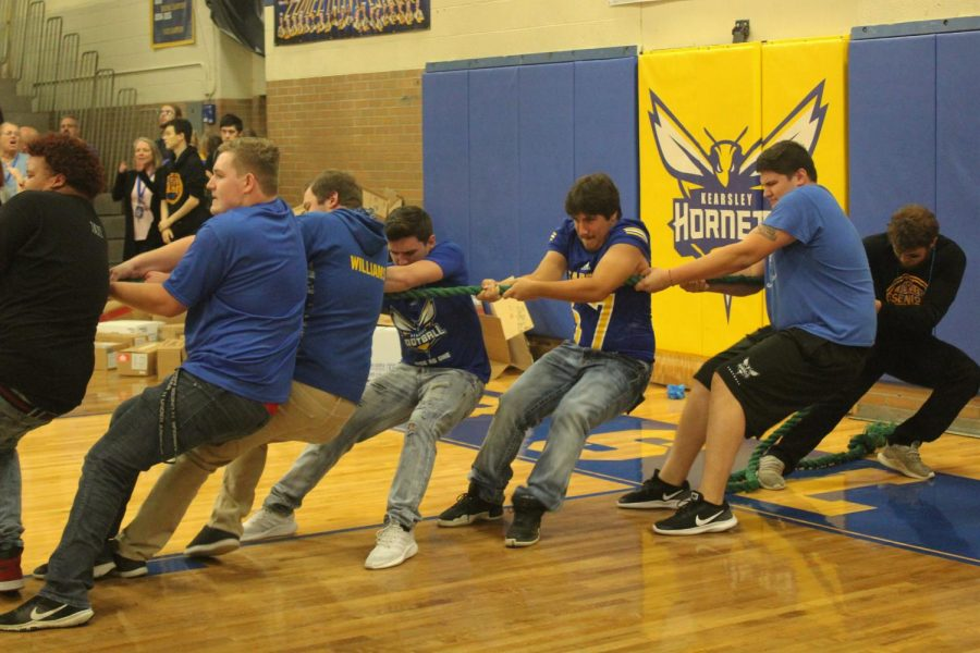 Seniors dont budge as they compete in tug-of-war at the homecoming pep assembly on Friday, Oct. 5.