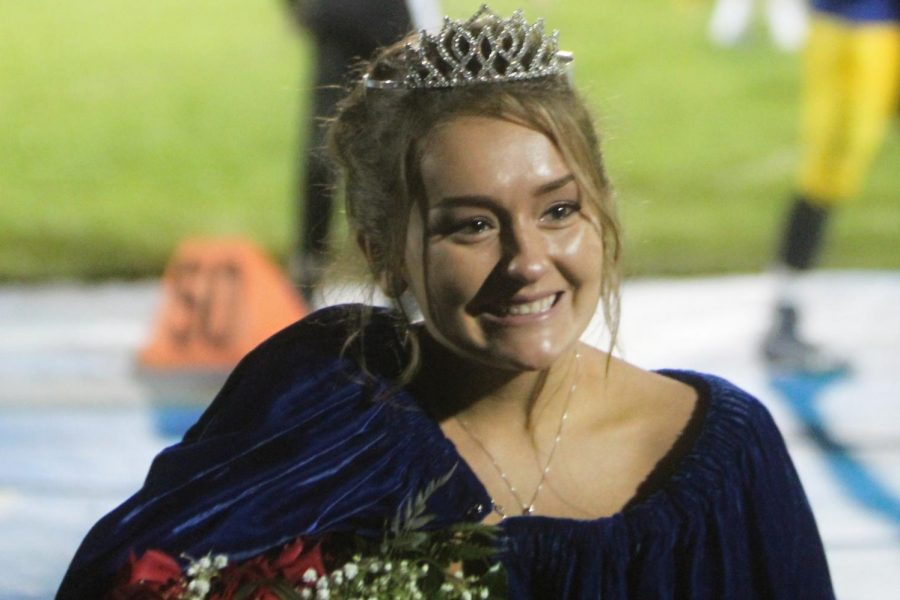Senior+Krista+Staley+poses+in+her+crown+and+queen%27s+cloak+after+she+was+named+2018+homecoming+queen+on+Friday%2C+Oct.+5.