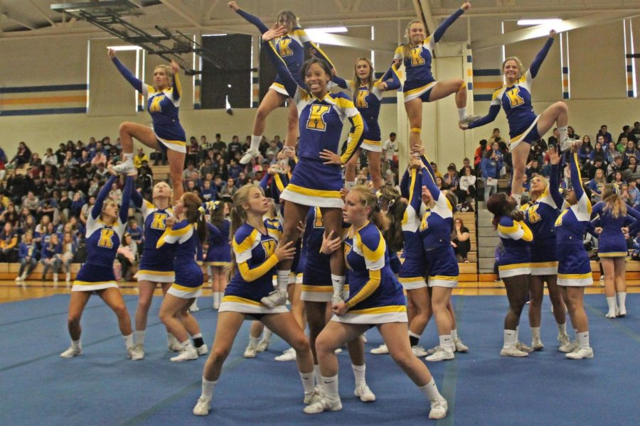 Cheer begins the pep assembly with a high-energy routine.