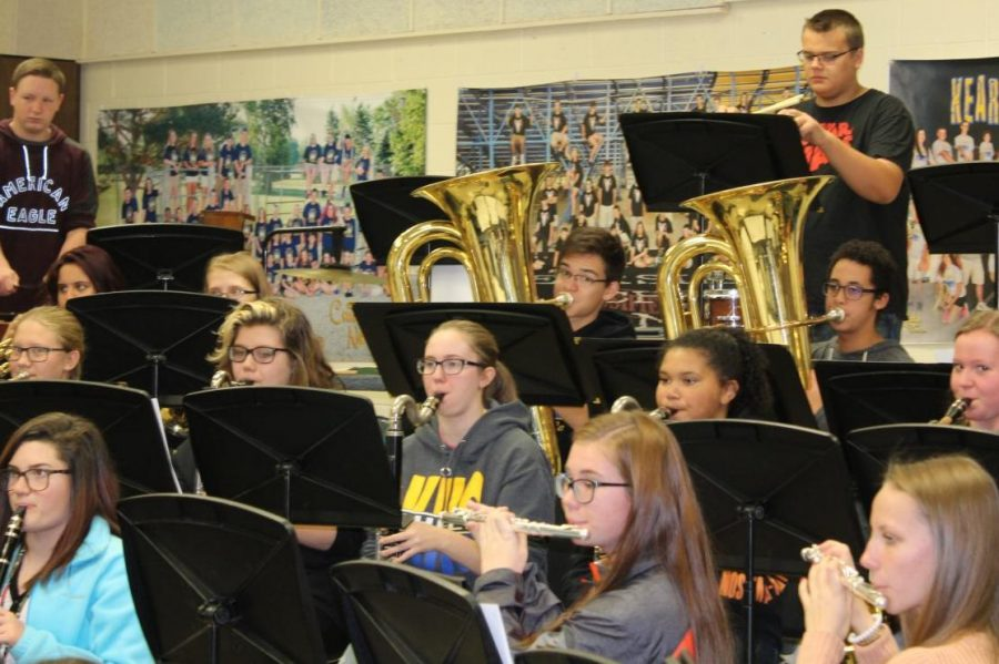 The symphonic band warms up before rehearsing.