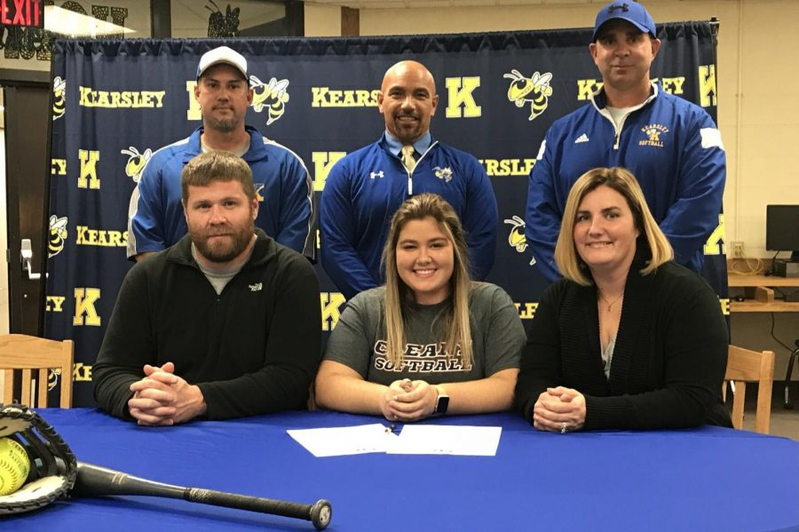 Senior Isabelle Easton (bottom, middle) signed a National Letter of Intent on Tuesday, Oct. 23, to play softball with Cleary University.