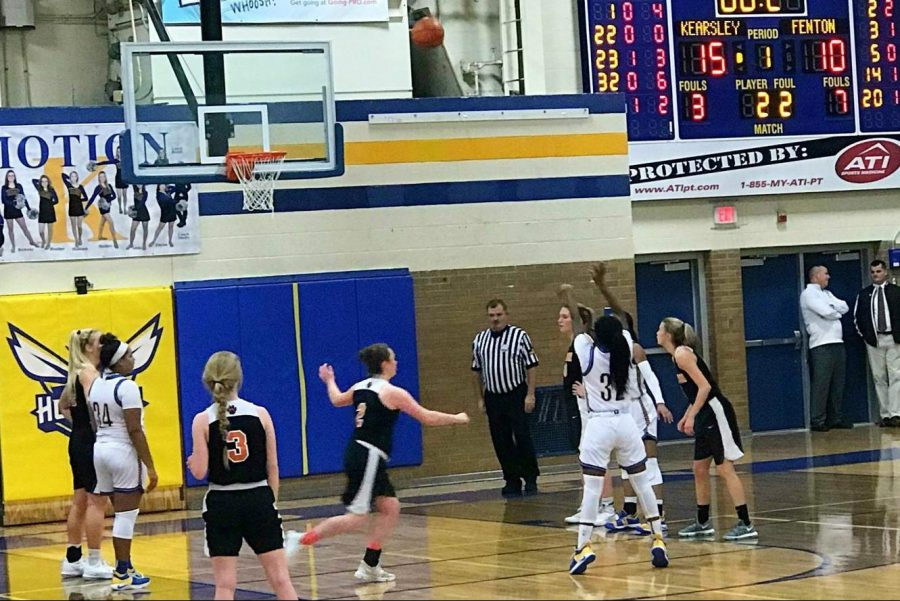 Junior Sydney Walker shoots a free throw in the first quarter of the Kearsley-Fenton basketball game Friday, Dec. 14. The Hornets lost the game.