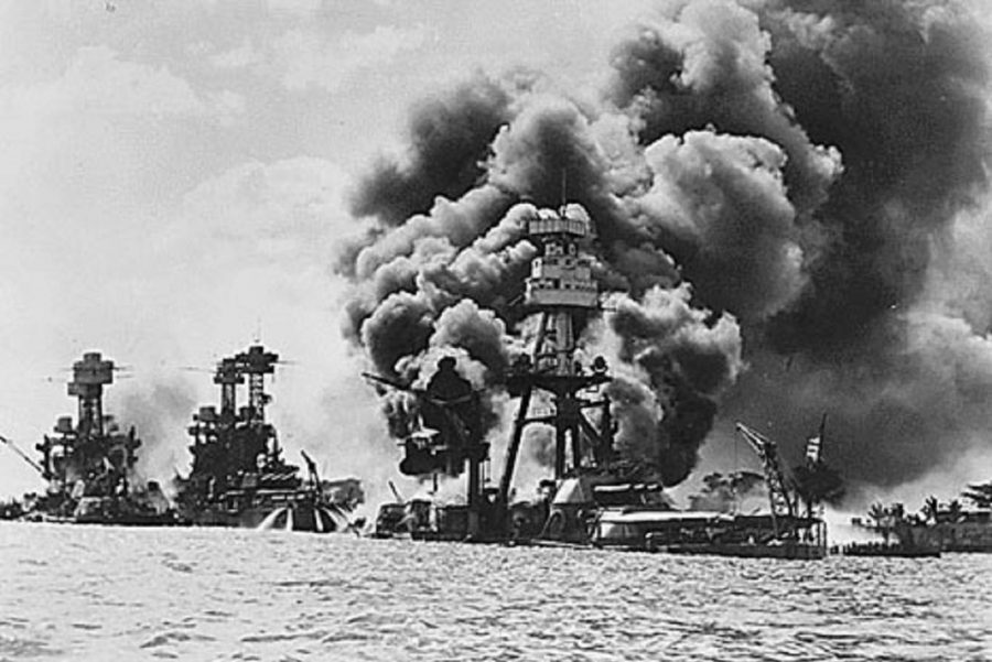Aftermath of the Japanese attack on Pearl Harbor on December 7, 1941: (l to r), USS West Virginia, USS Tennessee, and USS Arizona.