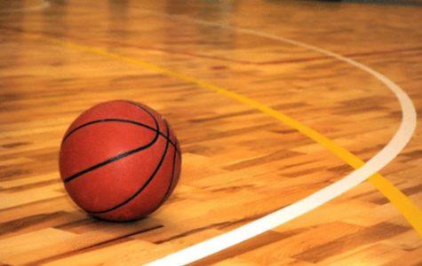 Girls basketball wins opener