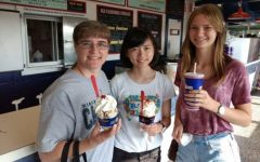 Mrs. Angela Hobson (l to r), senior Natsuho Kaneshiro, and senior Emelie Schuessler enjoy sweet treats. Hobson hosts the two exchange students.