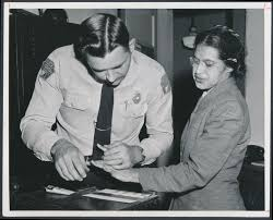 Mrs. Rosa Parks being fingerprinted by Sheriff D.H. Lackey for refusal to give up her seat to a white passenger and refusal to move to the back of the bus. This event marked the start of the Montgomery Bus Boycott.